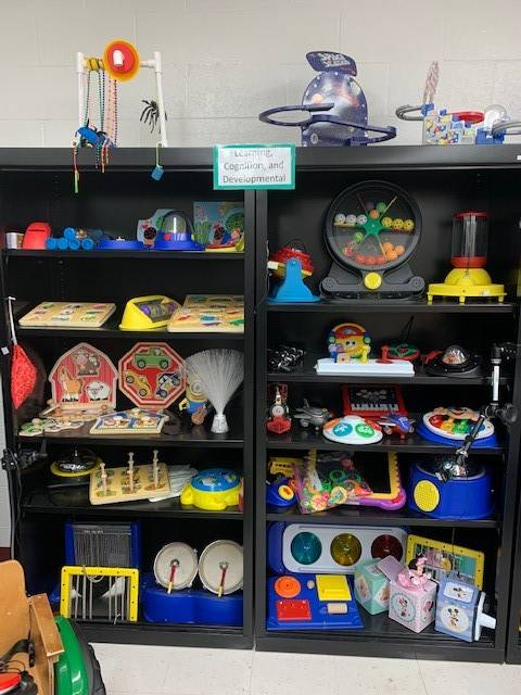 Adapted toys on a shelf