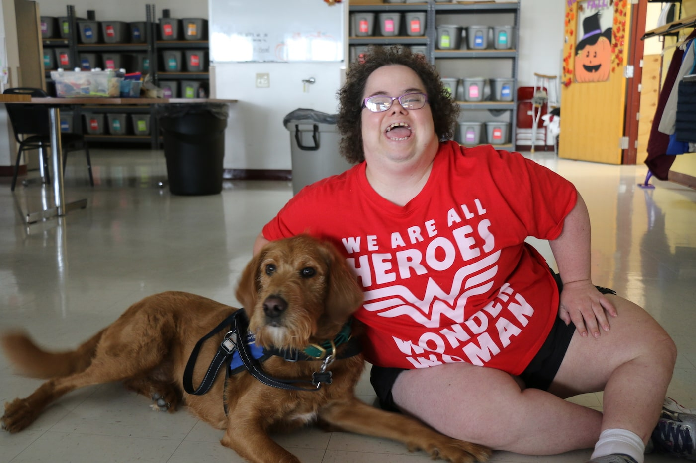 A Redwood client with her service dog.