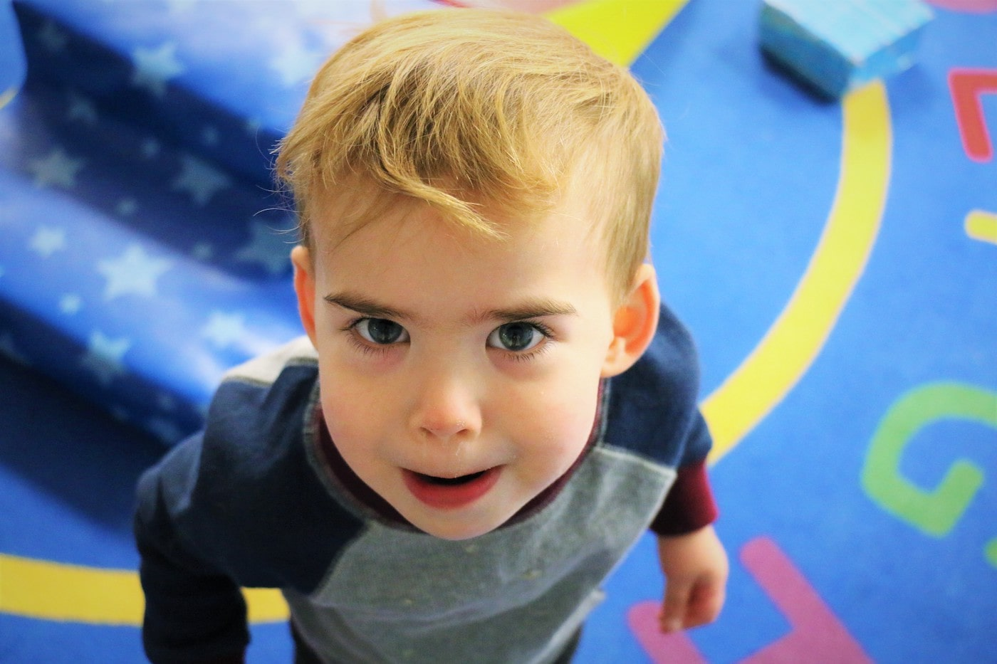 A young boy looking up at the camera.
