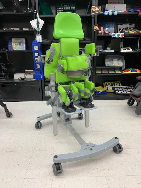 Patient standing device